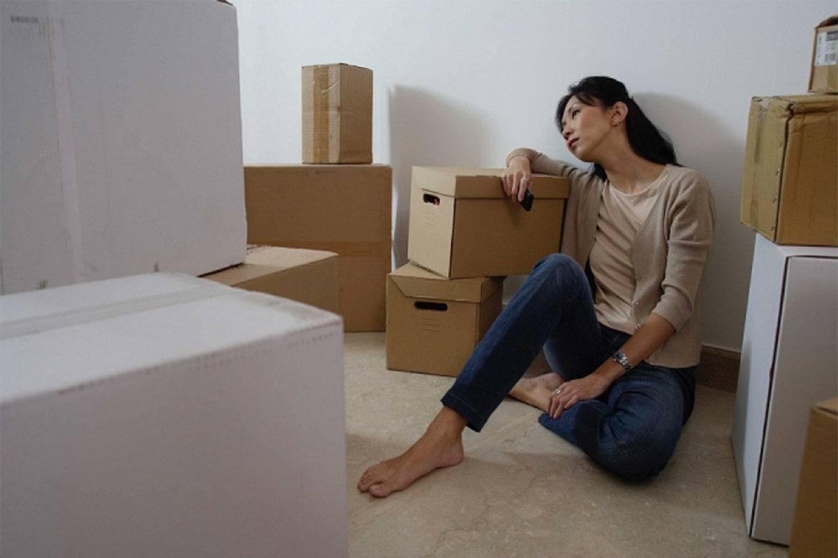 Woman resting, moving boxes