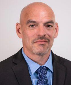 Headshot of Dennis Durkin